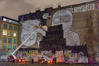 In the process of being painted over - art piece by BLU near Cuvrystrasse in Berlin. Photo by Davids via Tagesspiegel.de