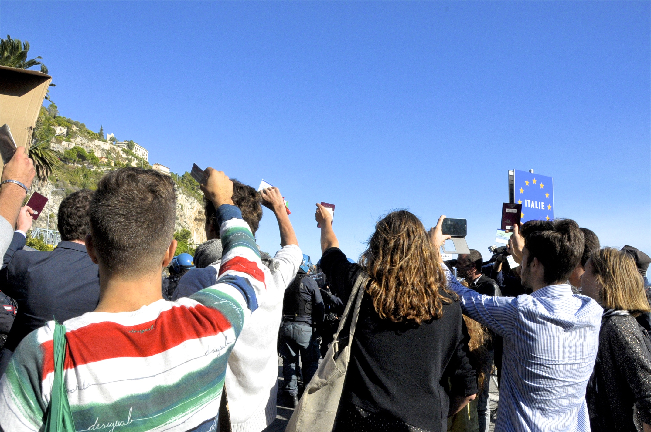 Students waving their identification at the French-Italian border, September 30th, 2015. Photo: Jacquelyn Rudich